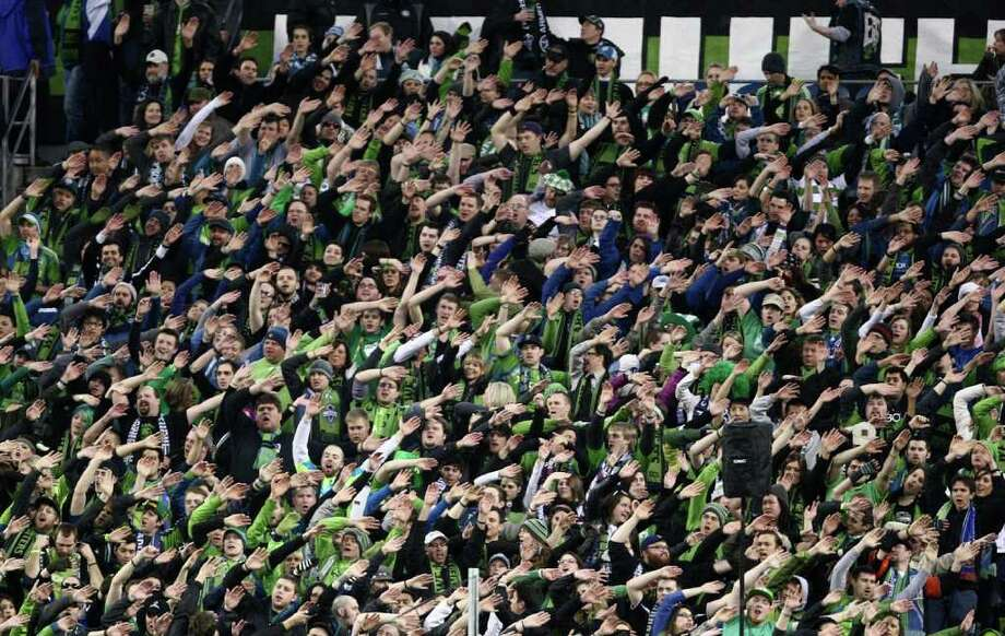 Sounders fans cheer during the Seattle Sounders MLS season opener against Toronto FC on Saturday, March 17, 2012 at CenturyLink Field in Seattle. Photo: JOSHUA TRUJILLO / SEATTLEPI.COM