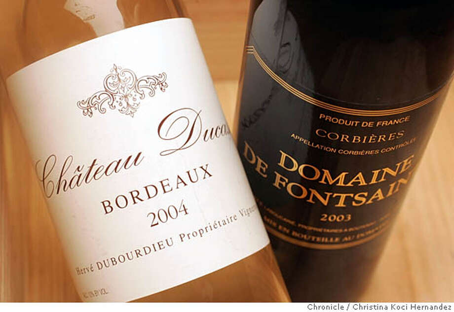 CHRISTINA KOCI HERNANDEZ/CHRONICLE  or the Bargain Wines column, we need the much-beloved bottle shot of: 2004 Chateau Ducasse Bordeaux (white) and 2003 Domaine de Fontsainte Corbieres. Photo: CHRISTINA KOCI HERNANDEZ
