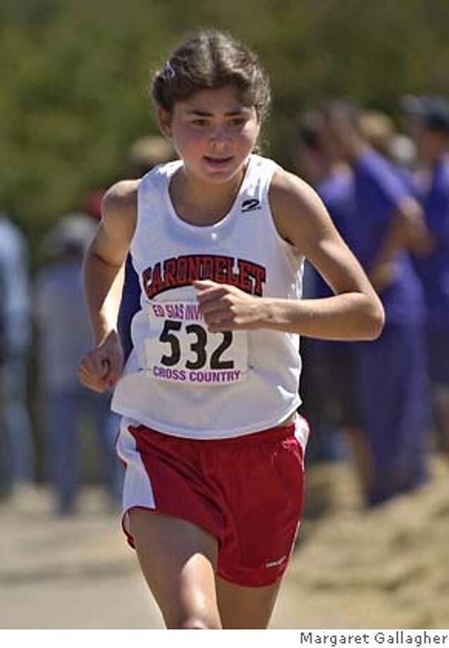 Carondelet freshman Nicole Hood, who is the top runner for the state's top-ranked Division II team. Here she's on her way to the title at the Ed Sias Invitational in Martinez. �  PHOTO CREDIT: Margaret Gallagher  Ran on: 10-18-2006  Nicole Hood, a freshman, helped the Cougars to a third-place finish at the Nike-Jim Danner Invitational in Oregon. Photo: Margaret Gallagher