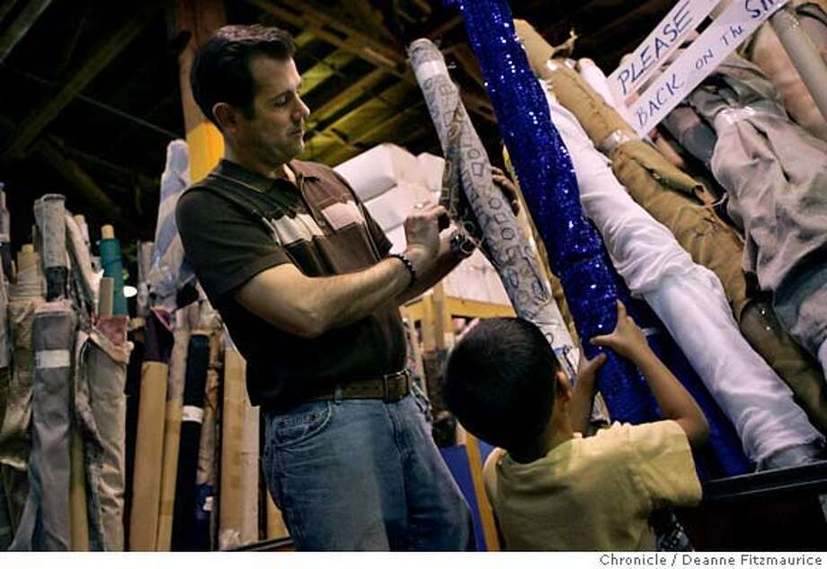 "compact13_001_df John Perry and his son Ben Perry-Picciotto, 4, shop at a scrap yard called ""Scrap"" in San Francisco. they are members of a group called the Compact who are ""getting off the first-market consumerism grid"" and refuse to buy new products in 2006.  San Francisco Chronicle photo by Deanne Fitzmaurice Photo: Deanne Fitzmaurice"