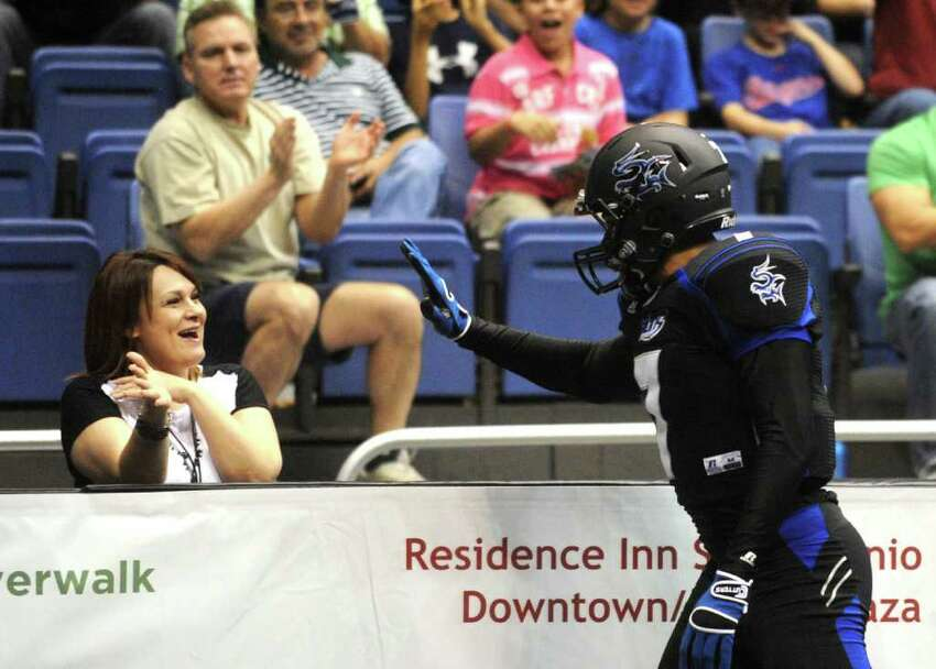 Jason Willis of the San Antonio Talons offers a high-five to a fan after scoring a touchdown against the Spokane Shock during AFL action in the Alamodome on Saturday, March 17, 2012. Billy Calzada / San Antonio Express-News