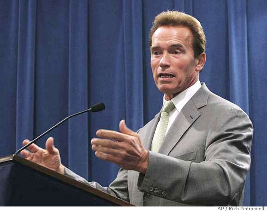 California Gov. Arnold Schwarzenegger announces that he will call the Legislature in for a special session to deal with health reform and water issues, during a Capitol news conference, in Sacramento, Calif., Tuesday, Sept. 11, 2007. (AP Photo/Rich Pedroncelli) Photo: Rich Pedroncelli