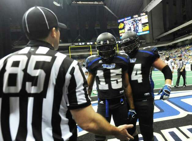 Jomo Wilson (15) of the San Antonio Talons has a discussion with an official during AFL action against Spokane in the Alamodome on Saturday, March 17, 2012.  Billy Calzada / San Antonio Express-News Photo: Billy Calzada, Express-News / San Antonio Express-News
