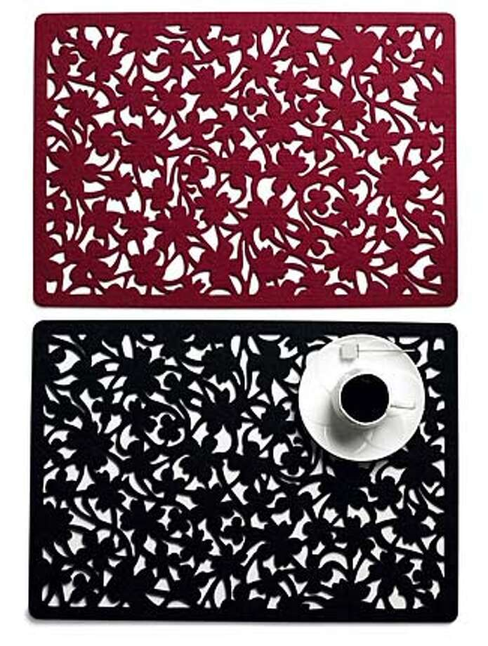 Flower placemats in red or black felt are $32 for a set of four at the MoMA Store. See story for details. Illustrates DESIGN-FALL (category l), by Jura Koncius (c) 2007, The Washington Post. Moved Thursday, Sept. 6, 2007. (MUST CREDIT: MoMA Design Store.) Photo: MOMA DESIGN STORE