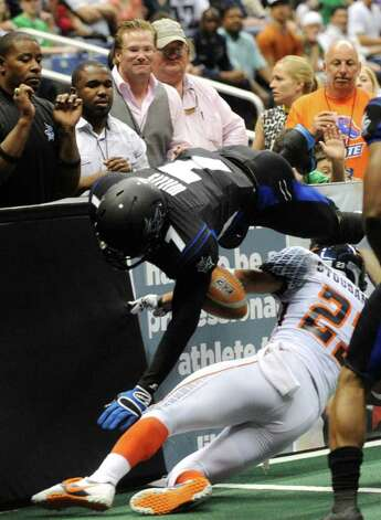 Receiver Jason Willis (7) of the San Antonio Talons fumbles the ball as he is hit by Patrick Stoudamire (23) of the Spokane Shock during AFL action in the Alamodome on Saturday, March 17, 2012.  Billy Calzada / San Antonio Express-News Photo: Billy Calzada, Express-News / San Antonio Express-News