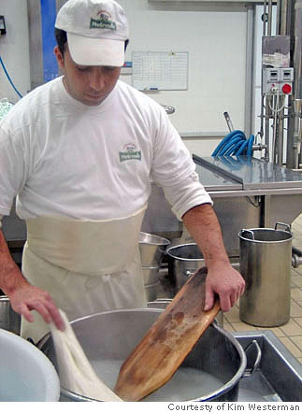 A Puglian cheesemaker stretches fresh mozzarella before shaping it into a pouch to make burrata. Photo courtesy of Kim Westerman