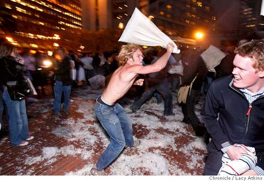 Dwight Crow clobbers Fredrick Schuller during the massive pillow fight along with the hundreds of people to celebrate Valentines Day, Feb. 14, 2006 at San Francisco�s Justin Herman Plaza. Photographer:Atkins, Lacy Photo: LACY ATKINS