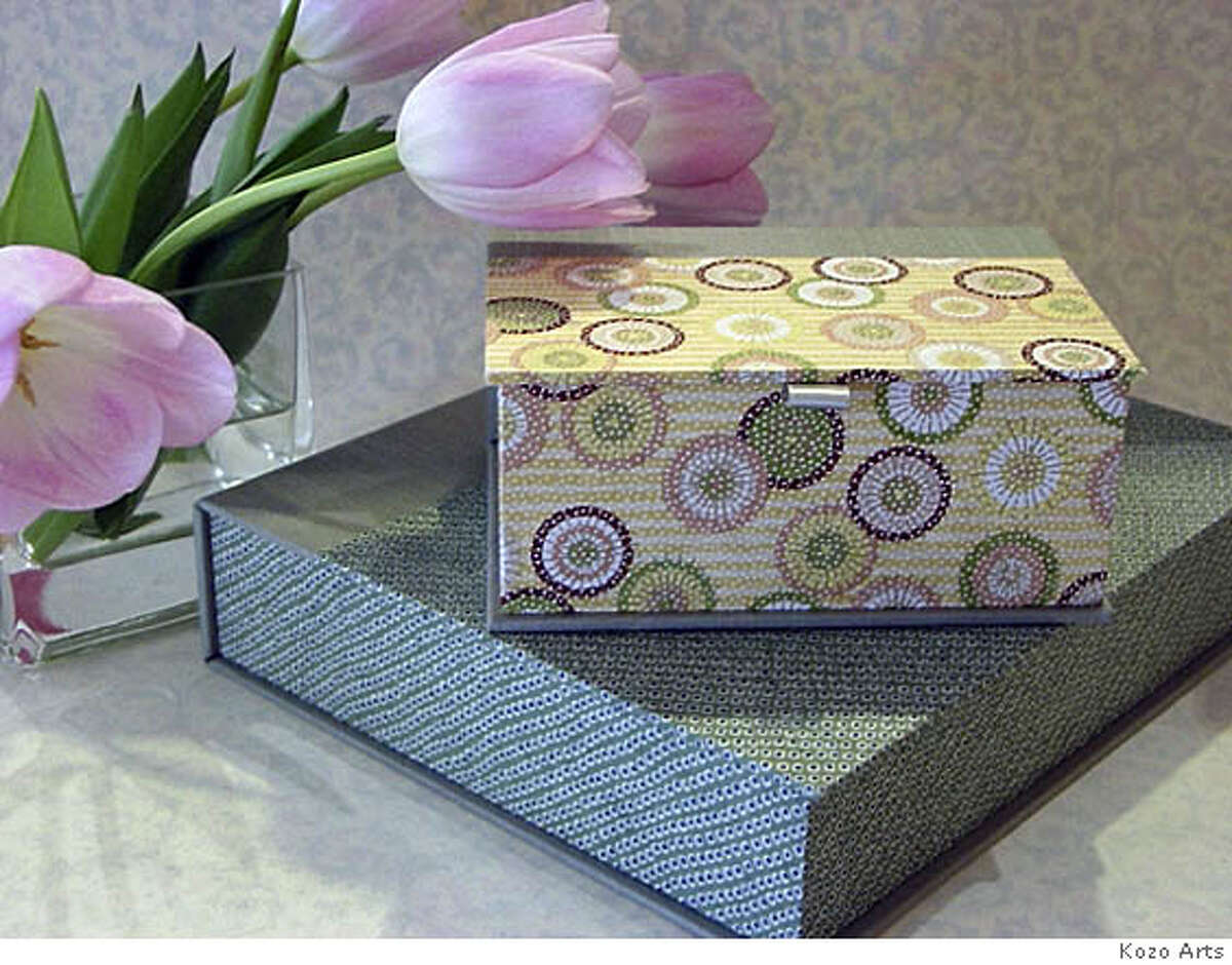 Kozo Arts combines fabric and papers to create treasured photo boxes, albums and frames. Photo courtesy Kozo arts