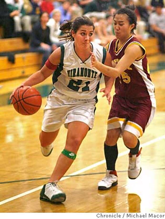 miramonte15_129_mac.jpg Miramonte's 21- Katie Batlin, drives past Northgate's 25- Jenny Inouye in the first half. High School Girls Basketball, between Miramonte and Northgate.Event in Moraga, Ca on 2/15/06 Photo by : Michael Macor/ San Francisco Chronicle Mandatory credit for Photographer and San Francisco Chronicle/ - Magazines Out Photo: Michael Macor