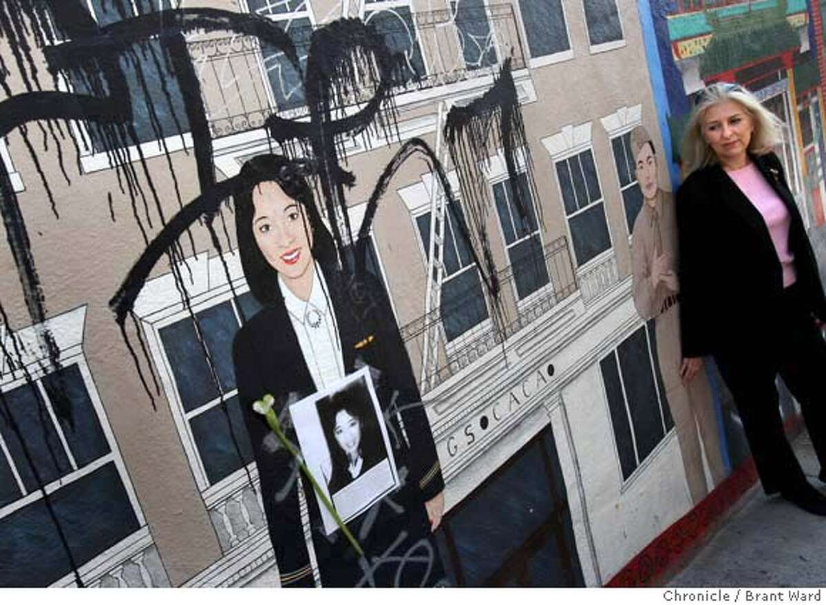 mural11_231.JPG Mural artist Ann Sherry, far right, looks over the portrait of Betty Ong that has been defaced recently. One of the few local monuments to Berry Ong, a San Francisco native who was killed six years ago while working on Flight 11 on Sept. 11, 2001, is a North Beach mural that has been defaced again. Ong is just one of the Chinatown luminaries honored in the mural done by Ann Sherry. Now the damage is so extensive, the mural will have to be sanded off and redone. {By Brant Ward/San Francisco Chronicle}9/10/07