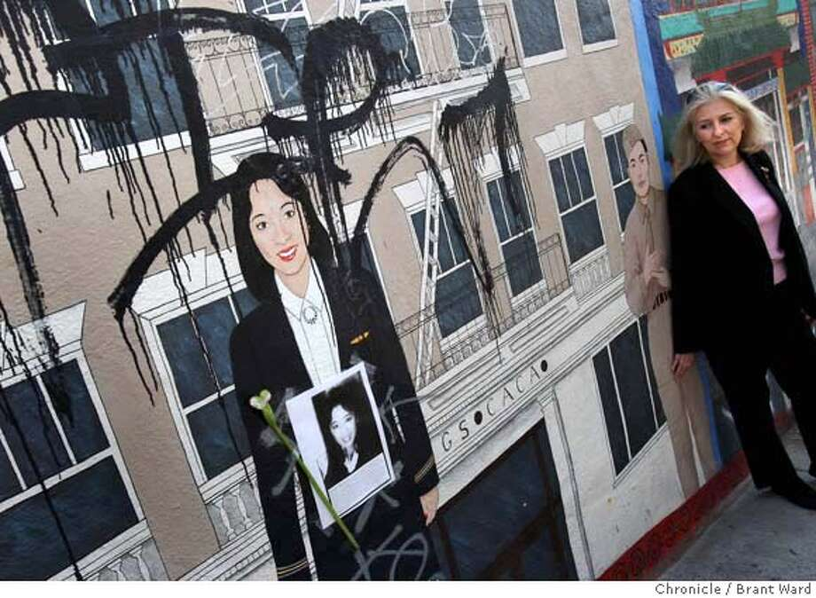 mural11_231.JPG  Mural artist Ann Sherry, far right, looks over the portrait of Betty Ong that has been defaced recently.  One of the few local monuments to Berry Ong, a San Francisco native who was killed six years ago while working on Flight 11 on Sept. 11, 2001, is a North Beach mural that has been defaced again. Ong is just one of the Chinatown luminaries honored in the mural done by Ann Sherry. Now the damage is so extensive, the mural will have to be sanded off and redone. {By Brant Ward/San Francisco Chronicle}9/10/07 Photo: Brant Ward