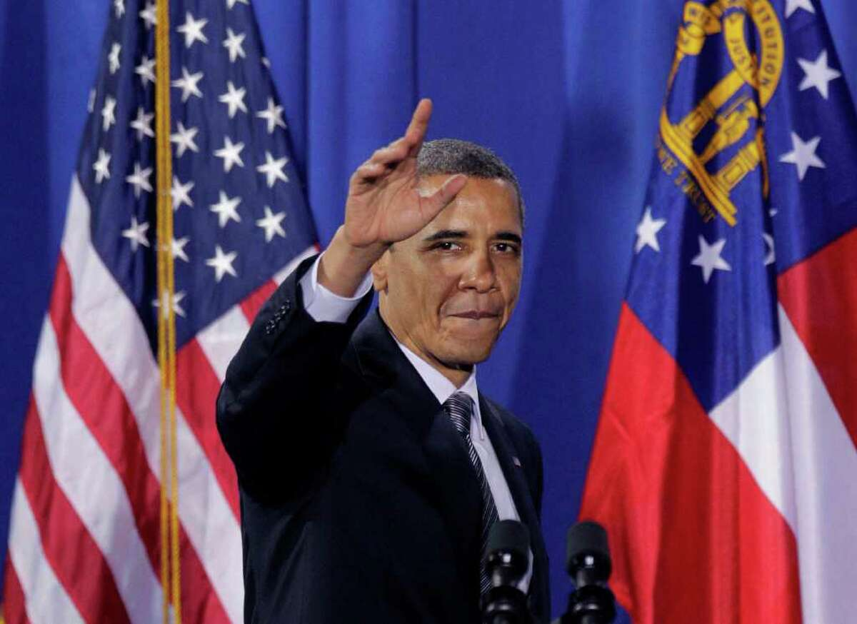 President Barack Obama eaves to the crowd after speaking during a fundraiser at the film studio of actor Tyler Perry Friday, March 16, 2012, in Atlanta. (AP Photo/David Goldman)