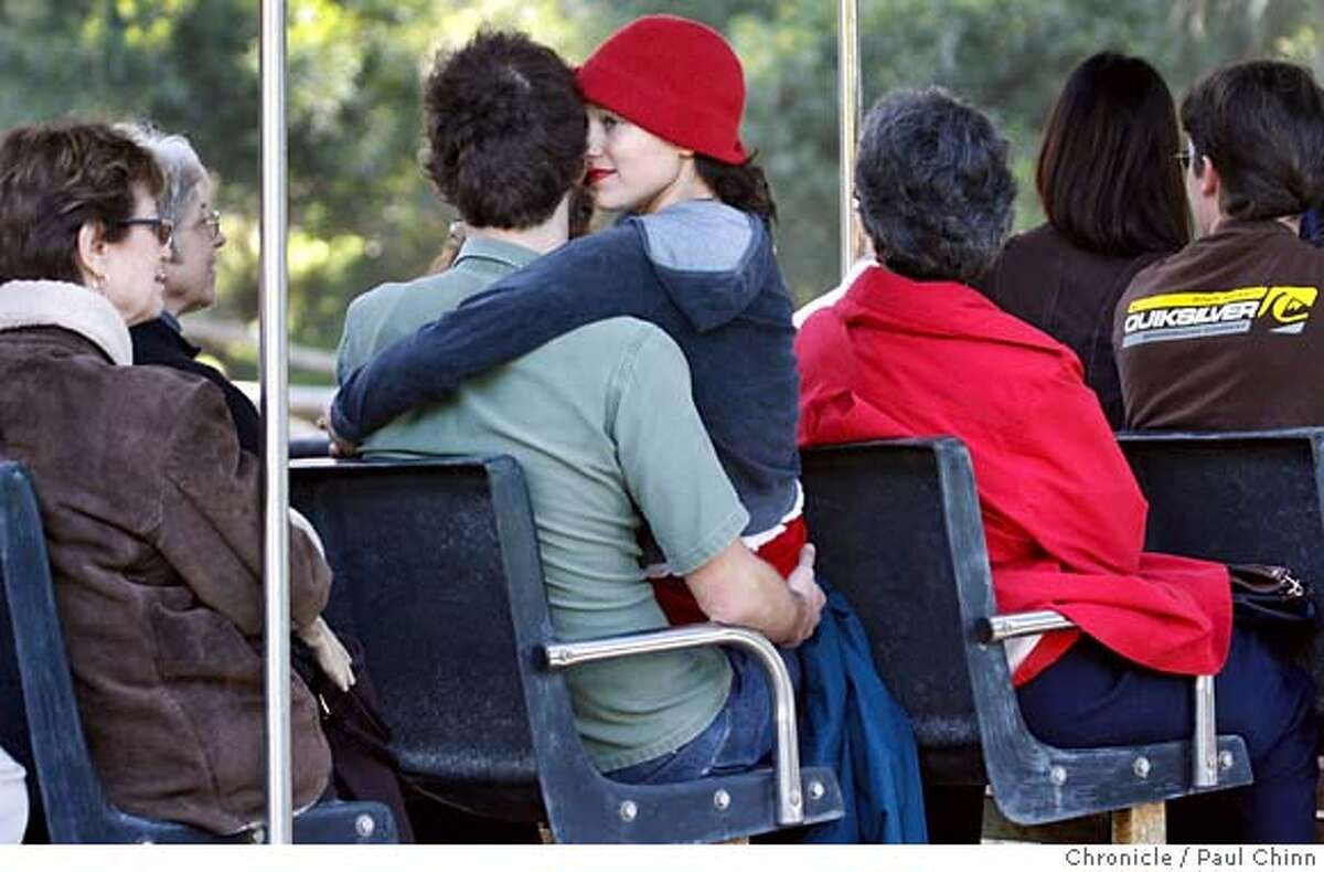 Iris Garcia snuggles with her boyfriend Adam Wier as they ride on the tram during the popular animal sex tour at the San Francisco Zoo on Valentine's Day in San Francisco, B.C. on 2/14/06. PAUL CHINN/The Chronicle MANDATORY CREDIT FOR PHOTOG AND S.F. CHRONICLE/ - MAGS OUT