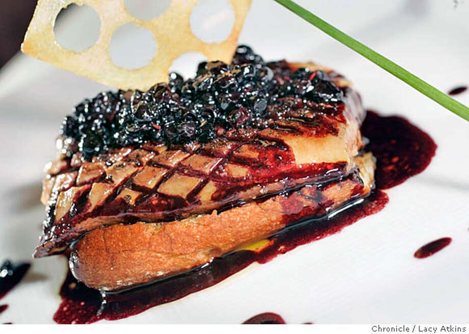 """Dishes Seared Hudson Valley Foie gras  and  Roasted Venaison on a Red Cabbage """"Chouroute"""" Huckleberries are turning up on menus in all kinds of dishes. What's New column will examine this trend in the lead piece. At La Folie, Roland Passot uses huckleberries in savory dishes such as roast venison loin with prune-potato Gateau, wild huckleberries and sauce poivrade (it's on the prix-fixe menu that is offered for dinner).  Photographer Lacy Atkins Photo: LACY ATKINS"""