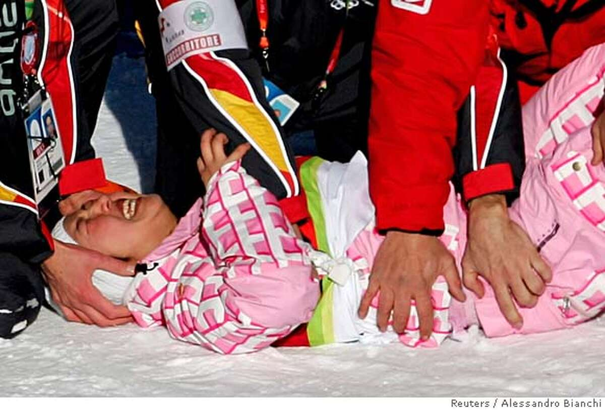 Japan's Melo Imai is taken away after getting injured while competing during qualification in the women's half pipe snowboarding competition at the Torino 2006 Winter Olympic Games in Bardonecchia, Italy, February 13, 2006. REUTERS/Alessandro Bianchi 0