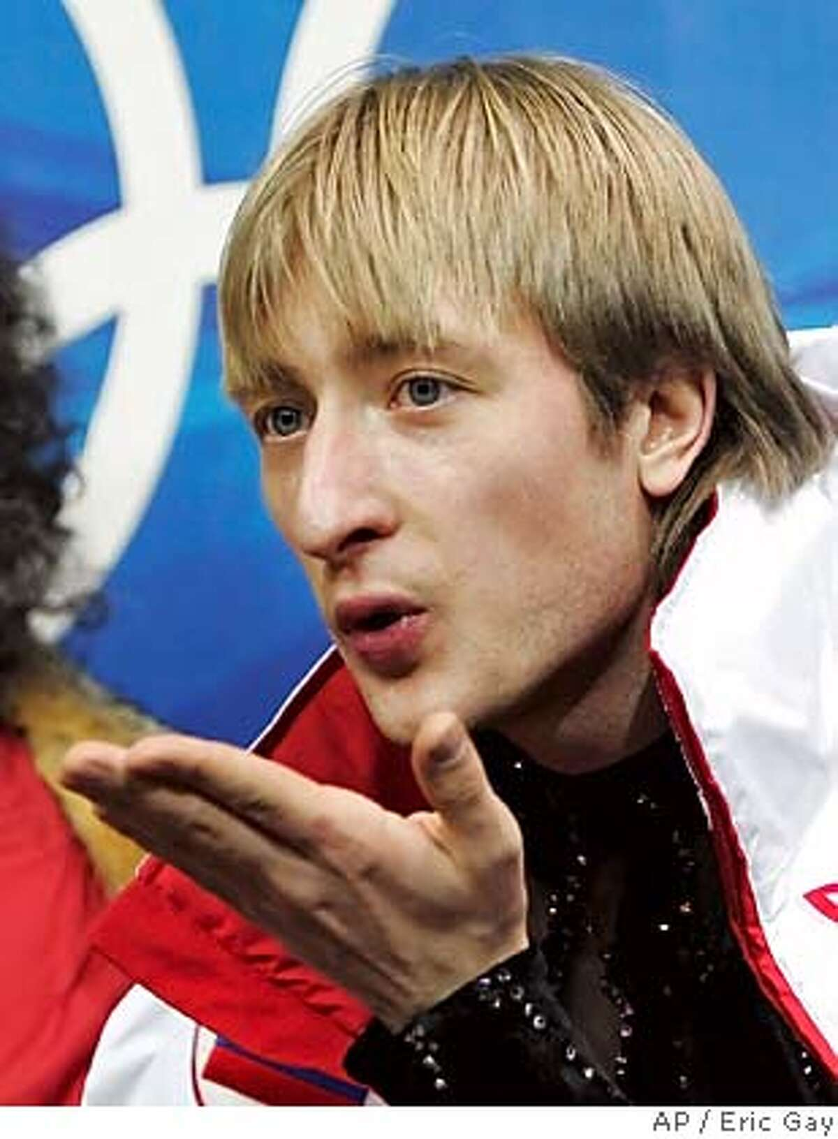 Russia's Evgeni Plushenko after his performance in the Men's Figure Skating short program at the Turin 2006 Winter Olympic Games in Turin, Italy, Tuesday, Feb. 15, 2006. (AP Photo/Eric Gay)