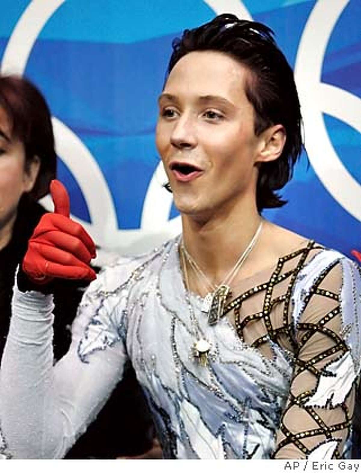 United States' Johnny Weir gives the thumbs up after receiving his scores for his performance in the Men's Figure Skating short program at the Turin 2006 Winter Olympic Games in Turin, Italy, Tuesday, Feb. 14, 2006. (AP Photo/Eric Gay)