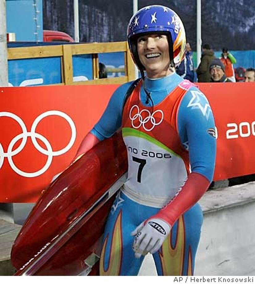 The United States Courtney Zablocki waves after completing her second run in the Women's Singles Luge at the Turin 2006 Winter Olympic Games at Cesana Pariol, Italy, Monday, Feb. 13, 2006. (AP Photo/Herbert Knosowski) Photo: HERBERT KNOSOWSKI