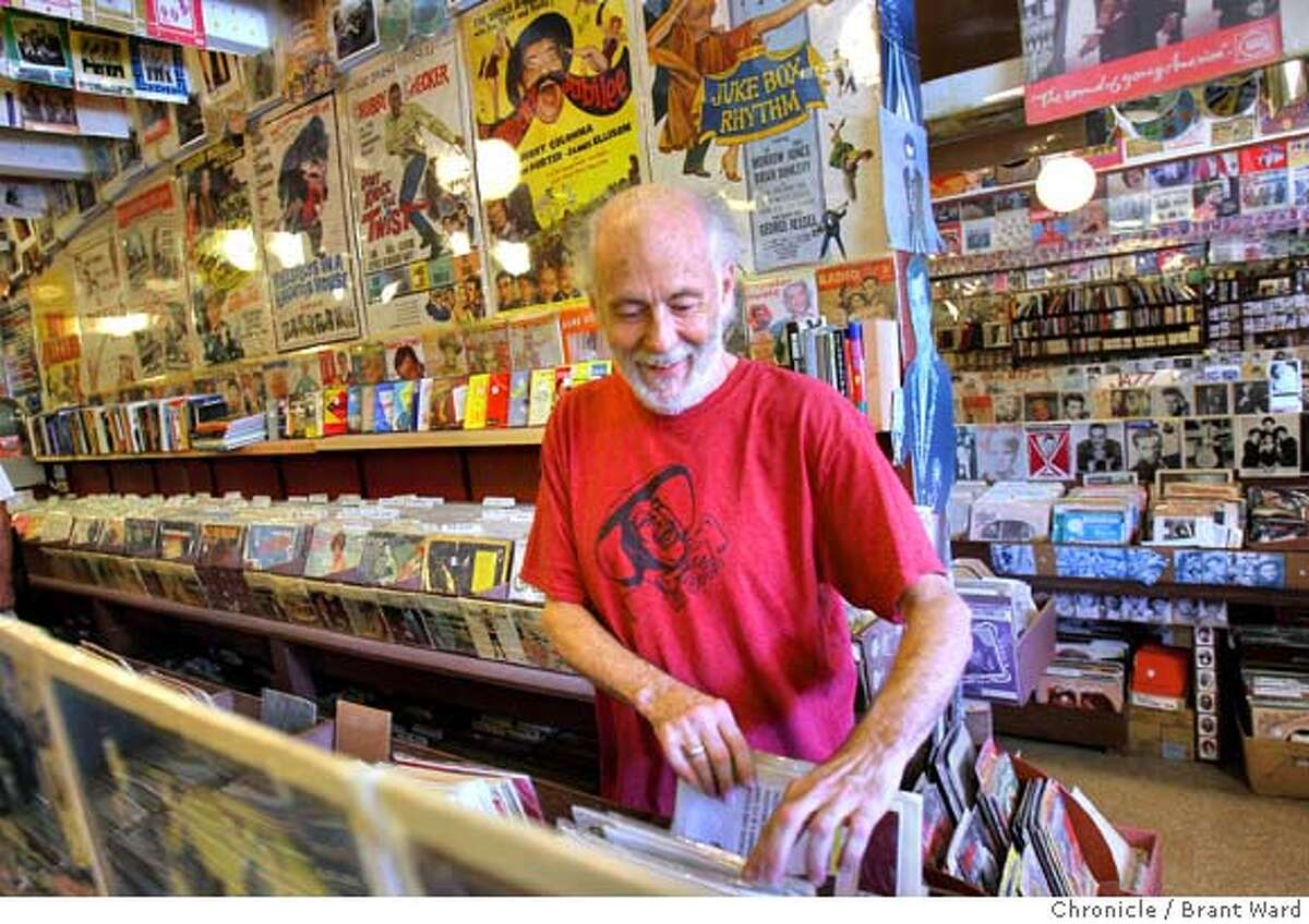 goddard_236.JPG John Goddard searched for some sheet music amongst the music paraphernalia at his store. John Goddard is closing his legendary Mill Valley record store called Village Music at the end of September. He talked about the music business at Village Music, 3 East Blithedale. {By Brant Ward/San Francisco Chronicle}8/28/07