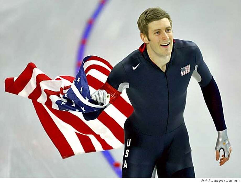 United States Joey Cheek, from Greensboro, N.C., holds an American national flag as he makes a victory lap during the Winter Olympics men's 500 meter speedskating sprint race at the Oval Lingotto in Turin, Italy, Monday, Feb. 13, 2006. Cheek won the gold medal in event. (AP Photo/Jasper Juinen) Photo: JASPER JUINEN