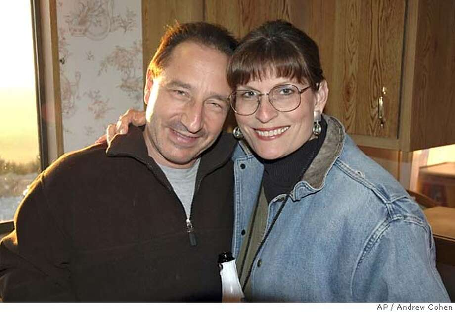 ** ADDS RESTRICTIONS - MAGS OUT - FILE ** This is a Jan. 23, 2005, file photo of Daniel Horowitz and his wife, Pamela Vitale. Horowitz rose to public prominence providing commentary last year during the trial of Scott Peterson, convicted of murdering his pregnant wife. But the lens turned after Horowitz returned to his rural hilltop estate in Lafayette, Calif., on Saturday evening and reported finding the body of his wife, dead from a blow to the head. (AP Photo/Andrew Cohen) ** MAGS OUT ** MAGS OUT Photo: ANDREW COHEN