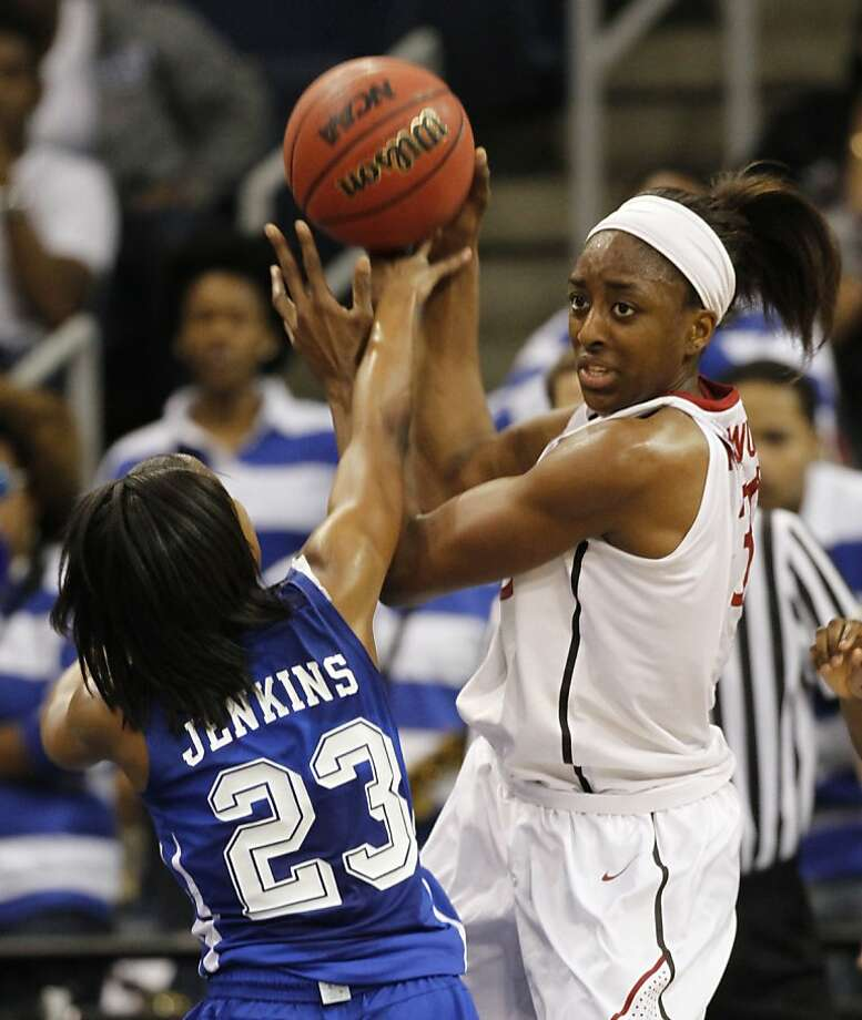 Stanford forward Nnemkadi Ogwumike (30) gets pressure from Hampton guard Jericka Jenkins (23) during the first half of a first-round NCAA tournament women's college basketball game in Norfolk, Va., Saturday, March 17, 2012.    (AP Photo/Steve Helber) Photo: Steve Helber, Associated Press