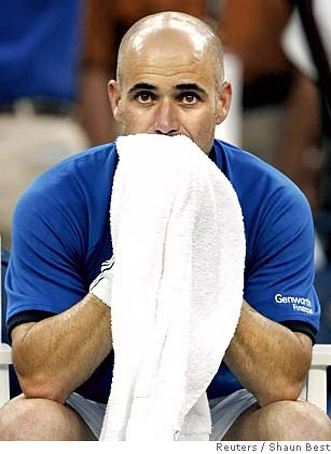 Andre Agassi of the U.S. sits following his loss to Roger Federer of Switzerland in the final of the U.S. Open tennis tournament in Flushing Meadows, New York, September 11, 2005. Federer defeated Agassi 6-3 2-6 7-6 6-1. REUTERS/Shaun Best Ran on: 09-12-2005  Roger Federer joins Don Budge as men to win Wimbledon and the U.S. Open in back-to-back years. 0 Photo: SHAUN BEST