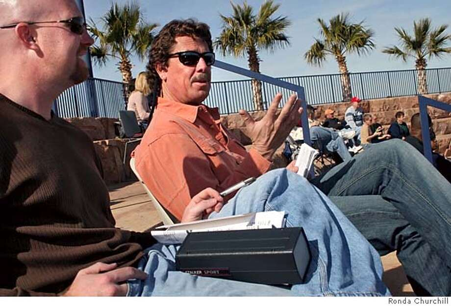 Oakland A's former pitcher Matt Keough (center) talks with fellow Oakland A's scout Jeremy Schied (left) during the Community College of Southern Nevada Coyote Classic at William R. Morse Stadium Friday, Feb. 3, 2006 in Henderson, Nev. Photo by Ronda Churchill Photo: Ronda Churchill