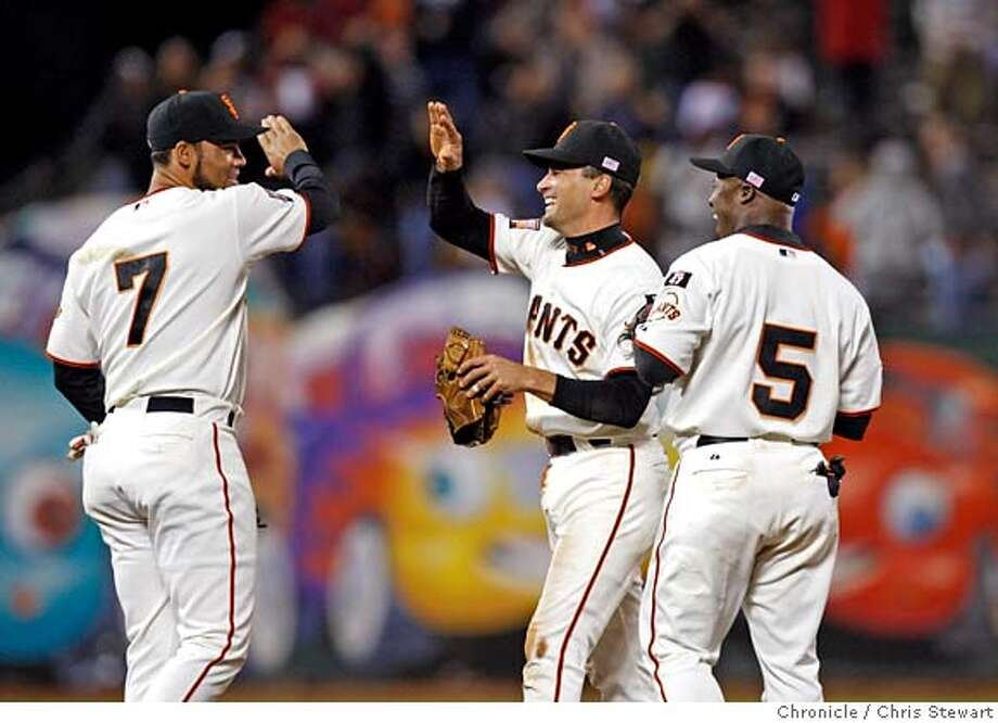 giants_0358_cs.jpg Event on 9/11/07 in San Francisco  The San Francisco Giants celebrate turning a double play and beating the Arizona Diamondbacks 2-1 at AT&T Park in San Francisco. Photographed September 11, 2007. Chris Stewart / The Chronicle San Francisco Giants, Arizona Diamondbacks Photo: Chris Stewart