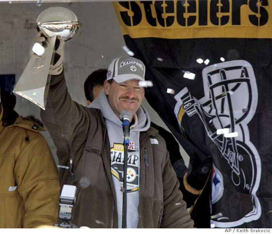 Super Bowl Champion Pittsburgh Steelers head coach Bill Cowher shows the Vince Lombardi Trophy to the fans gathered in front of the stage in downtown Pittsburgh after the team victory parade on Tuesday, Feb. 7, 2006. The Steelers beat the Seattle Seahawks in Super Bowl XL on Sunday in Detroit. (AP Photo/Keith Srakocic) Photo: KEITH SRAKOCIC