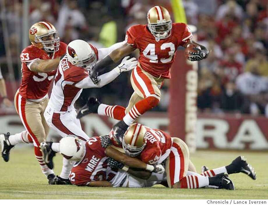 49ers Maurice Hicks hurdles Arizona defenders returning a punt in second quarter action. San Francisco 49ers Vs. Arizona Cardinals. SEPT 10, 2007. Lance Iversen/The Chronicle (cq) SUBJECT 9/10/07,in SAN FRANCISCO. CA. Photo: By Lance Iversen