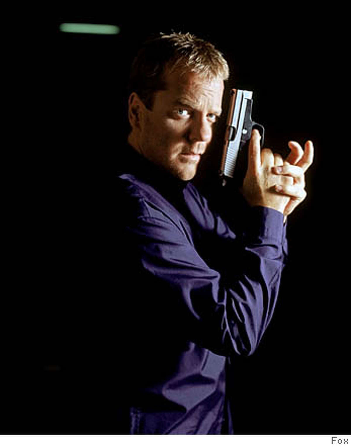 THIS IS A HANDOUT IMAGE. PLEASE VERIFY RIGHTS. GOODMAN28b-C-24OCT02-DD-HO Kiefer Sutherland as Jack Bauer on 24. ��2002 FOX BROADCASTING COMPANY. CAT