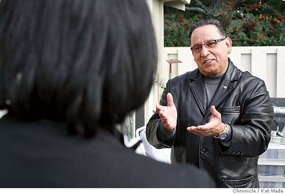DELAFUENTE_0028_KW_.jpg On 1/30/06 in Oakland Oakland Mayoral candidate Ignacio de la Fuente (RIGHT) talks with Paula Mitchell in the back yard at the home of Becky Taylor when he attends his 100th house party while on the campaign trail.  Kat Wade/The Chronicle Mandatory Credit for San Francisco Chronicle and photographer, Kat Wade, Mags out Photo: Kat Wade
