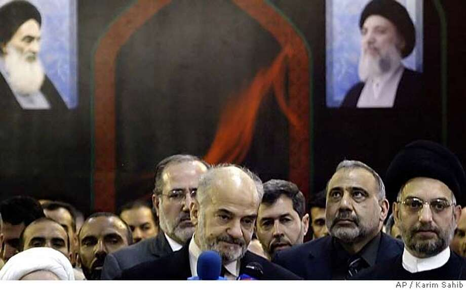 Iraqi Prime Minister Ibrahim al-Jaafari, center left, Vice President Adel Abdel Mehdi, center and Abdel Aziz al-Hakim, chief of the conservative Shiite United Iraqi Alliance attend a press conference, Sunday, Feb. 12, 2006 in Baghdad. Shiite lawmakers chose Prime Minister Ibrahim al-Jaafari to head the new government, selecting the incumbent by a one-vote margin over Vice President Adil Abdul-Mahdi, Shiite officials said.(AP Photo/Karim Sahib, Pool) Photo: KARIM SAHIB