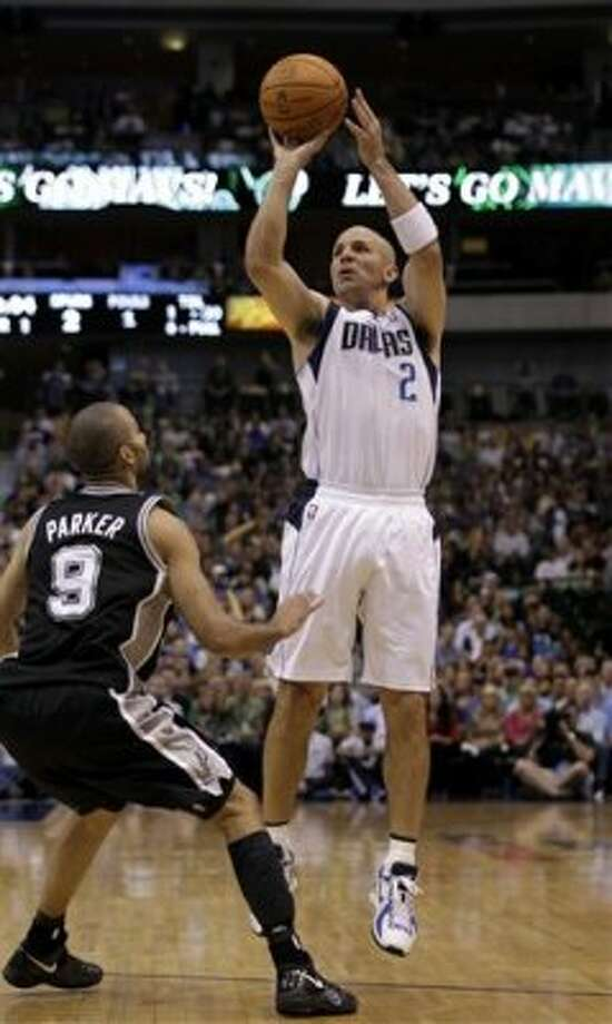 Dallas Mavericks point guard Jason Kidd (2) attempts a shot over San Antonio Spurs' Tony Parker (9) in the first half of an NBA basketball game Saturday, March 17, 2012, in Dallas. (AP Photo/Tony Gutierrez) (AP)