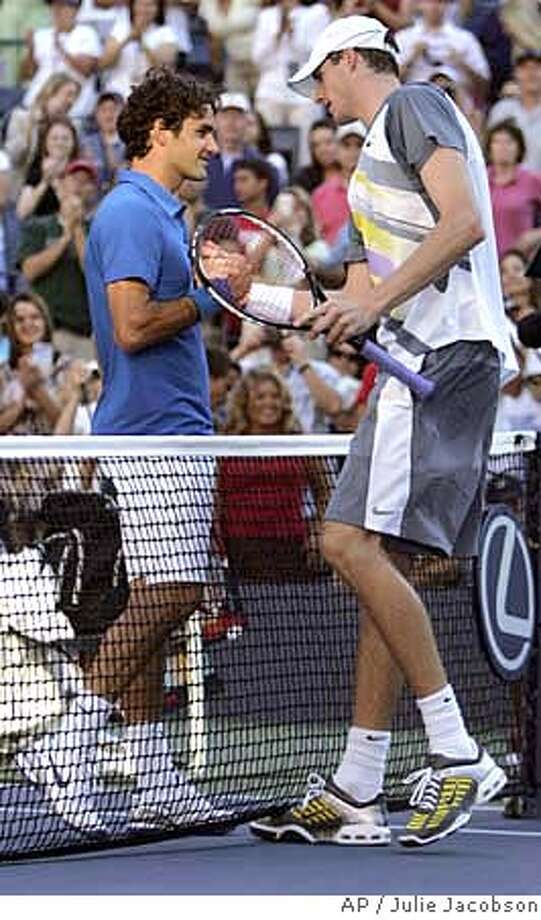 Roger Federer, left, of Switzerland shakes hands with John Isner of the United States after their match at the US Open tennis tournament in New York, Saturday, Sept. 1, 2007. (AP Photo/Julie Jacobson) Photo: Julie Jacobson