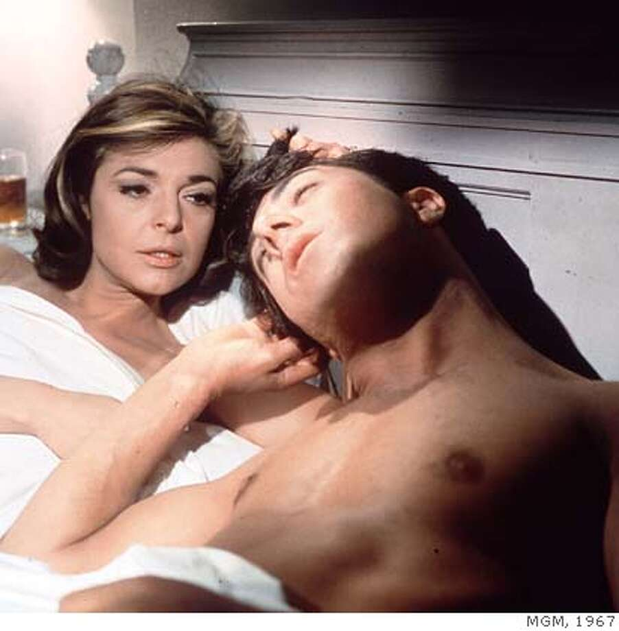 "In this publicity still, actors Anne Bancroft, left, and Dustin Hoffman appear in a scene from the 1967 film ""The Graduate."" Bancroft, who won the 1962 best actress Oscar as the teacher of a young Helen Keller in ""The Miracle Worker"" but achieved greater fame as the seductive Mrs. Robinson in ""The Graduate,"" died Tuesday June 7, 2005. She was 73. (AP Photo) Photo: Anonymous"