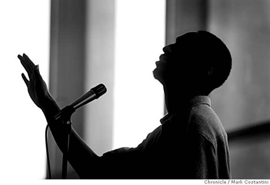 CAMPUSNOTES_0137  {2/11/06}  Sillouette of hip hop lyririsist Warren Longmire of Philadelphia reciting of his poems. during program.  At the Martin Luther King Student union on the UC Berkeley campus is a conference entitled:: �Redefining Reparations with the Hip Hop Nation.� The second annual Bridging the Gap Conference sponsored by the Graduate Minority Students� Project (GMSP) of the Graduate Assembly of UC Berkeley. The Saturday event featured Hip Hop historians, journalists, deejays and community activists and live performances.: workshops, discussions, free food, live performances Event on {2/11/06} in Berkeley, CA. Photo: Mark Costantini /San Francisco Chronicle. Photo: MARK COSTANTINI