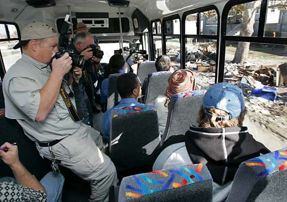 The first passengers take the Hurricane Katrina bus tour. Associated Press photo by Steve Helber