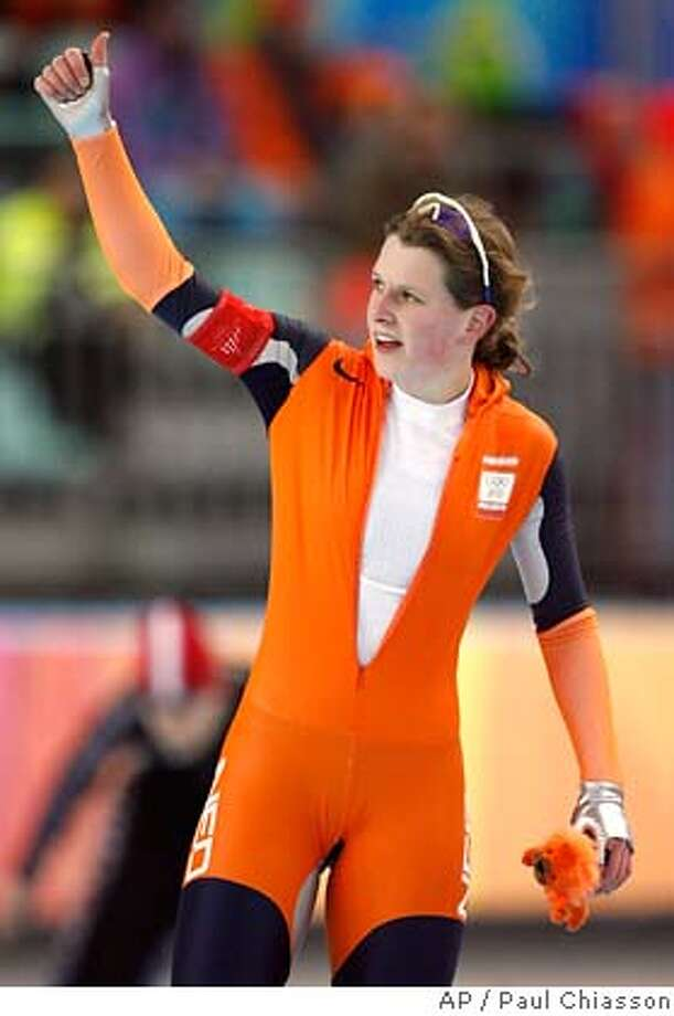 Netherlands' Ireen Wust salutes the crowd after competing in the ladies' 3000-meter speedskating and winning the Olympic gold medal at the Turin 2006 Winter Olympic Games, Sunday, Feb. 12, 2006 in Turin. (AP Photo/Paul Chiasson) COM Photo: PAUL CHIASSON