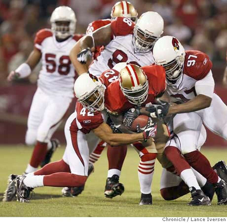 49ERS_CARDINALS_64589.JPG  49ers Frank Gore carries Arizona defenders as he makes a first down in second quarter action. San Francisco 49ers Vs. Arizona Cardinals. SEPT 10, 2007. Lance Iversen/The Chronicle (cq) SUBJECT 9/10/07,in SAN FRANCISCO. CA. Photo: By Lance Iversen