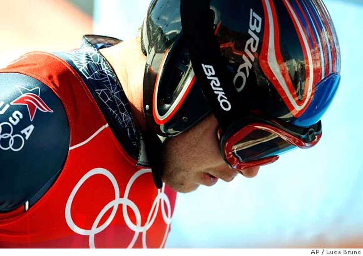Bode Miller of the United States reacts after completing the Men's Downhill at the Turin 2006 Winter Olympic Games in Sestriere Borgata, Italy, Sunday, Feb. 12, 2006. (AP Photo/Luca Bruno)