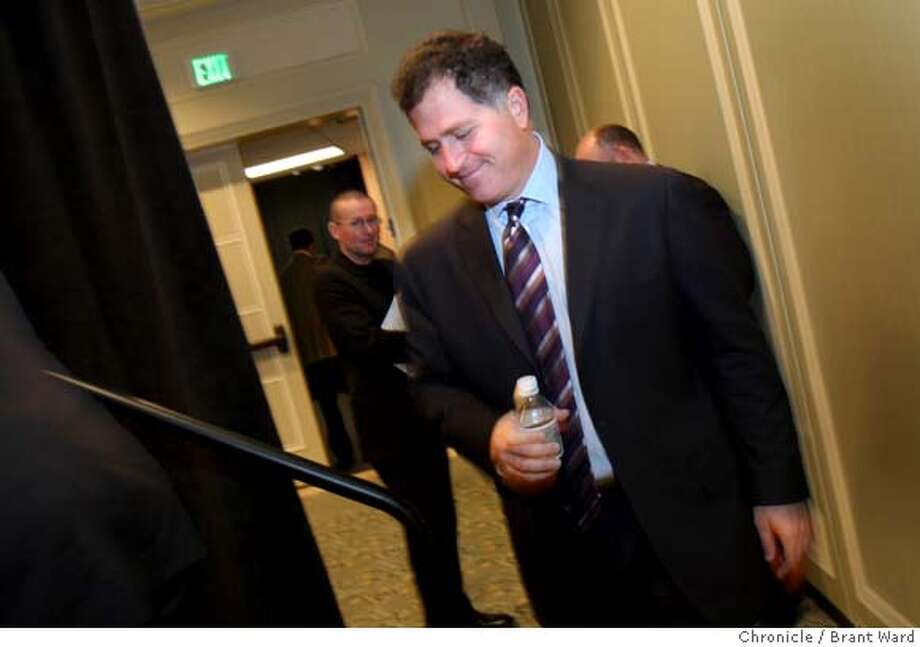 dell11_228.JPG  Michael Dell went from a large question and answer session to a smaller press conference in the hotel.  Computer whiz Michael Dell was in San Francisco Monday talking about new products. He was appearing with other Dell executives at the Four Seasons Hotel where he held a press conference. {By Brant Ward/San Francisco Chronicle}9/10/07 Photo: Brant Ward