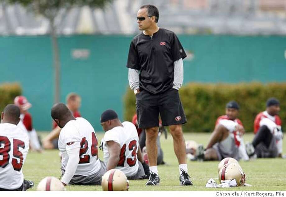 San Francisco 49ERS head coach Mike Nolan looks over the players during stretches.  The San Francisco 49ERS kicked off their Organized Training Activities at their Santa Clara training camp this was the second day.  TUESDAY, JUNE 5, 2007 KURT ROGERS SANTA CLARA SFC  THE CHRONICLE 49ERS_0044_kr.jpg  Ran on: 06-06-2007  Mike Nolan surveys the scene as the 49ers sweat through practice in Santa Clara. Nolan will have one more player to watch, newly signed lineman Sam Rayburn.  Ran on: 06-06-2007 Ran on: 06-06-2007 MANDATORY CREDIT FOR PHOTOG AND SF CHRONICLE / NO SALES-MAGS OUT Photo: KURT ROGERS