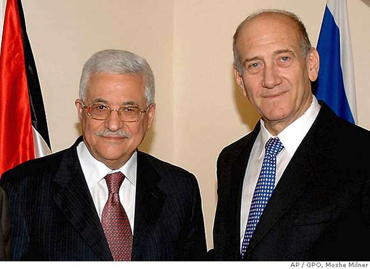 In this photo made available by the Government Press Office, Israeli Prime Minister Ehud Olmert, right, stands with Palestinian President Mahmoud Abbas, left, at the Prime Minister's Office in Jerusalem, Monday, Sept. 10, 2007. Israeli Prime Minister Ehud Olmert and Palestinian President Mahmoud Abbas sat down together on Monday to try to work out guidelines for resuming peace negotiation. Aides for both leaders said they would discuss issues connected with Palestinian statehood as well as day-to-day security and economic matters. (AP Photo / GPO, Moshe Milner, HO) ** ISRAEL OUT **