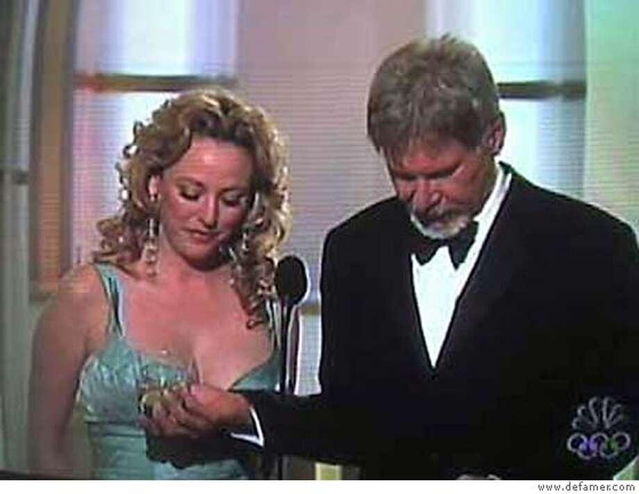 Virginia Madsen and Harrison Ford at the Golden Globes. Credit: www.defamer.com Photo: Www.defamer.com