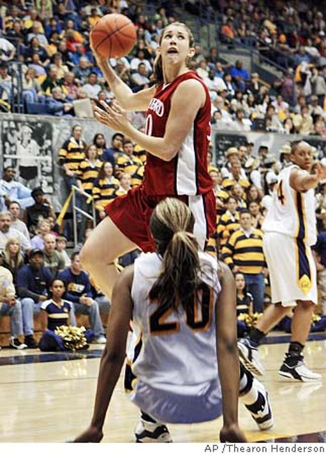 Stanford's Brooke Smith (30) puts up a hook shot after California's Devanei Hampton (20) fell to the floor during the first half of a college basketball game in Berkeley, Calif., Saturday, Feb. 11, 2006. (AP Photo/Thearon Henderson) Photo: THEARON HENDERSON