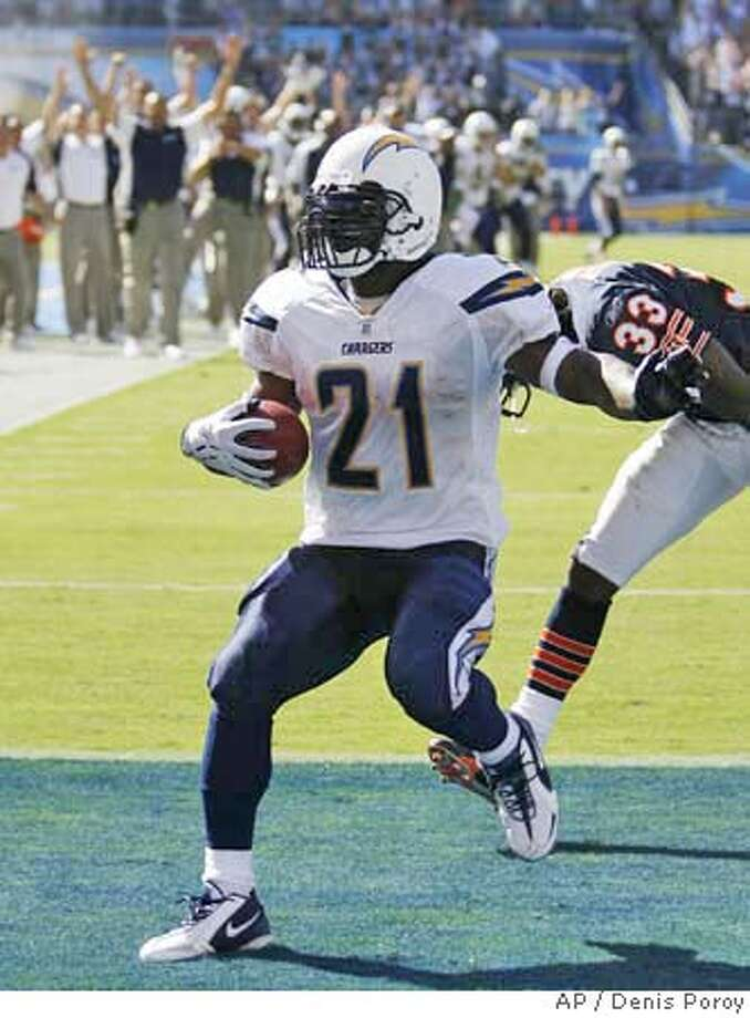 San Diego Chargers running back LaDainian Tomlinson (21) beats Chicago Bear's Charles Tillman (33) for a seven-yard touchdown in the fourth quarter of an NFL football game Sunday, Sept. 9, 2007, in San Diego. The Chargers won 14-3. (AP Photo/Denis Poroy) EFE OUT Photo: Denis Poroy