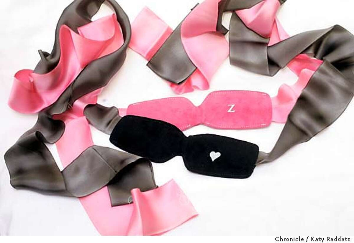 JIMMYJANE_024_RAD.JPG Jimmyjane is a San Francisco company that designs and markets sex toys and other objects of sensual delight. SHOWN: Two blindfolds, one in black, one in pink. They're made of soft suede with satin ribbons. And they're double sided--one side for sleeping (with the z), and one side for love (with the heart). Photo taken on 1/29/06, in San Francisco, CA. By Katy Raddatz / The San Francisco Chronicle MANDATORY CREDIT FOR PHOTOG AND SF CHRONICLE/ -MAGS OUT