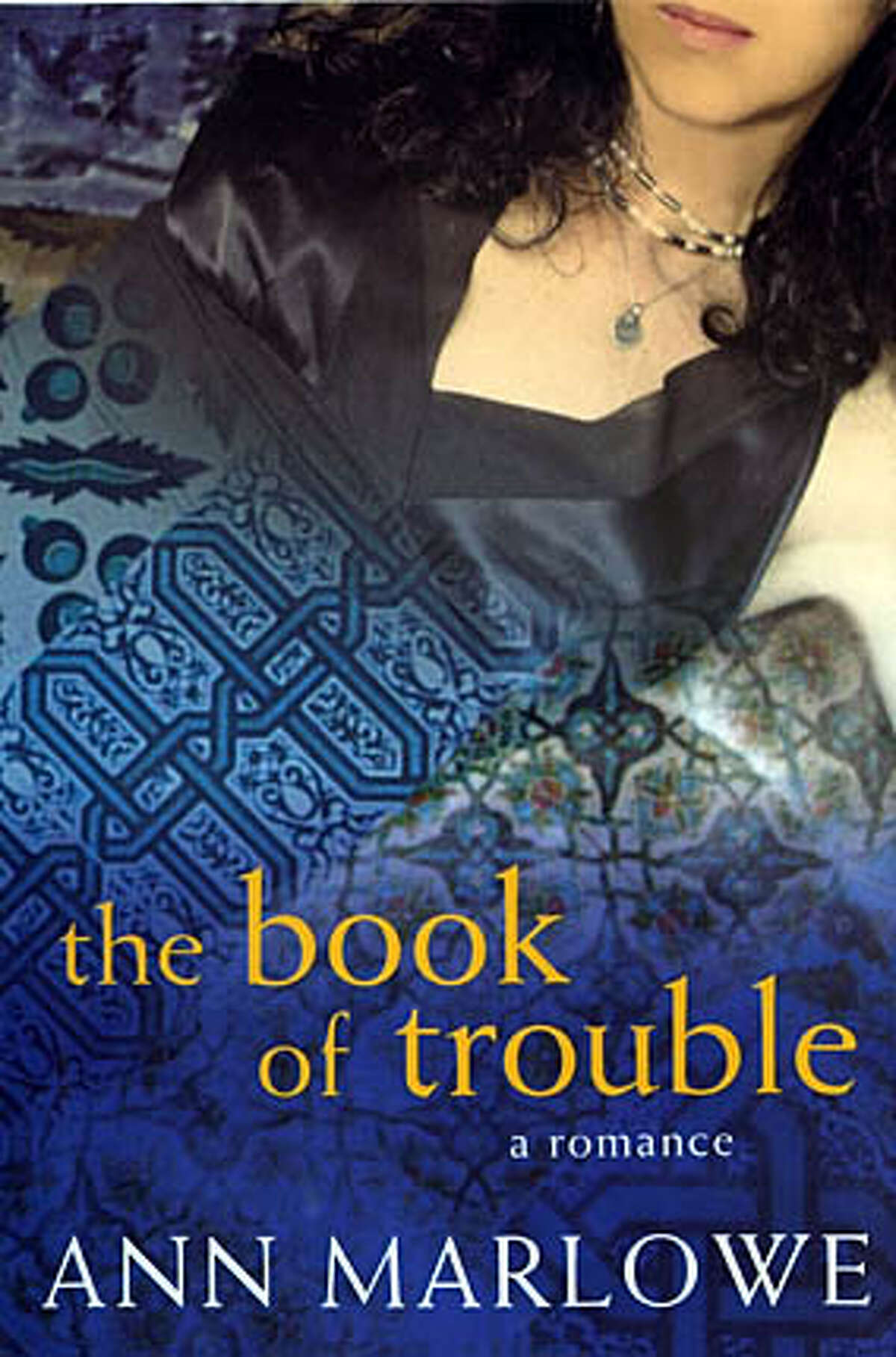 """Cover art for """"The Book of Trouble,"""" a romance by Ann Marlowe. Jacket design by Jennifer Jackman."""